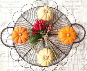 Pumpkins and peppers in a basket