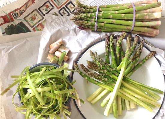 Green asparagus on newspaper II