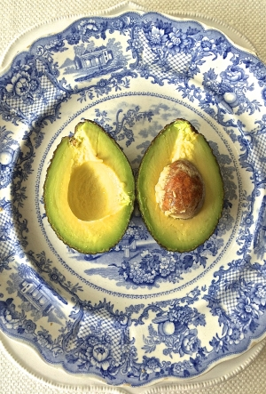 avocado on a blue platter