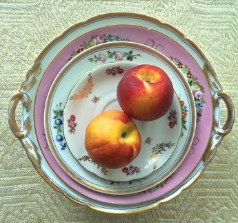 Peaches on golden plates