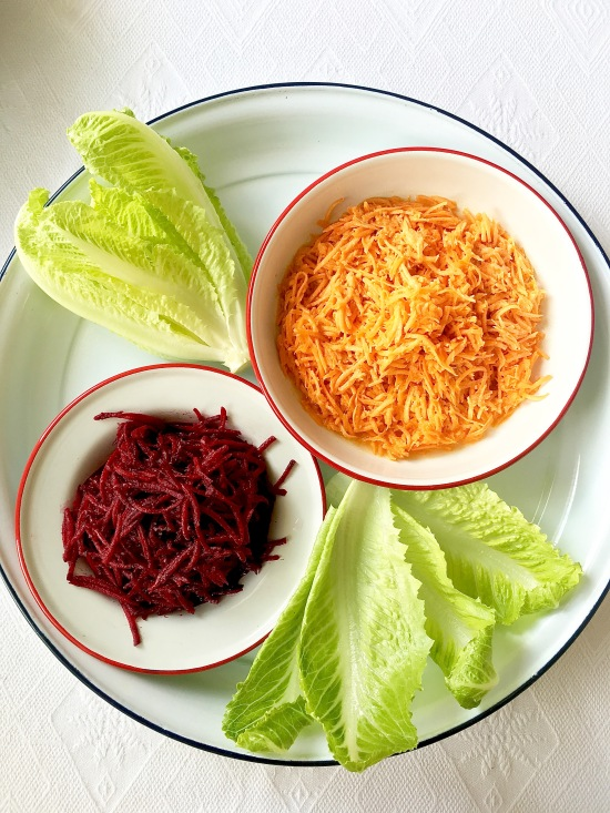 Lettuce leaves with beet and carrot salads