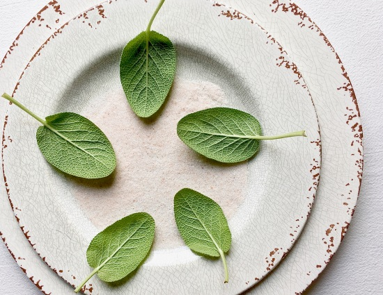 Sage leaves four on a plate