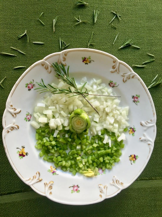 chopped-onions-and-celery-on-green-linen-vertical